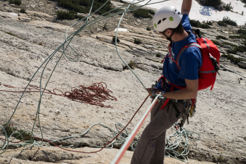 Josiah doing battle with spaghetti on rappel